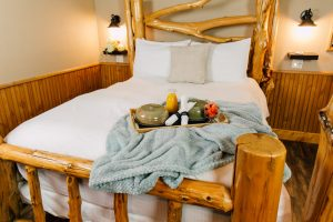 Bed in Ponderosa Room at Pine River Ranch
