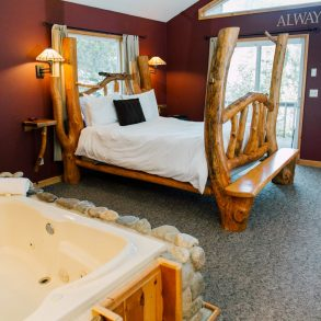 Bed in the Nason Suite at Pine River Ranch