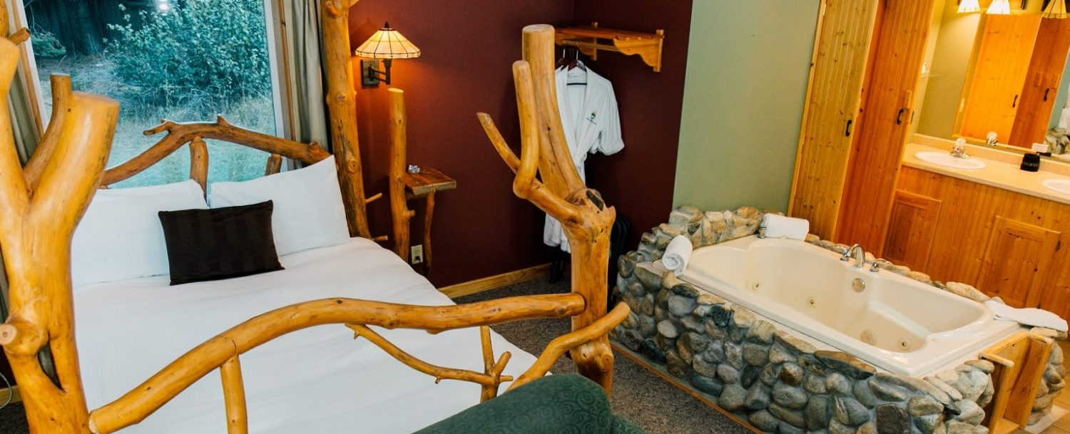 Bed in Natapoc Suite at Pine River Ranch
