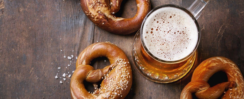 beer in stein with pretzels