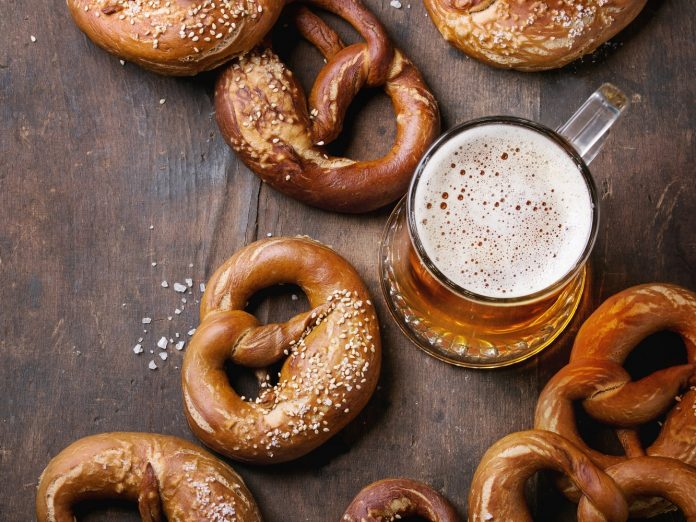 beer in stein with pretzels