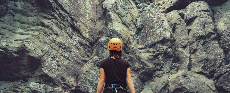woman preparing for rock climbing