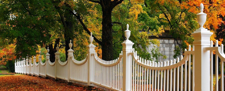 White fence and fall foliage
