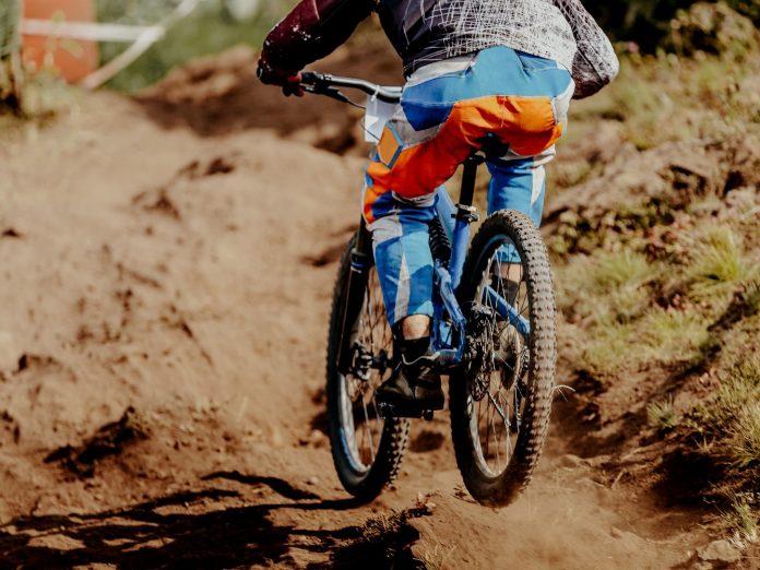 downhill xtreme rider man bike on mountain trail