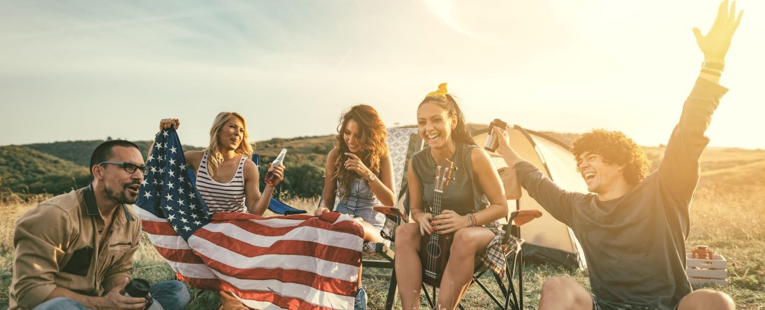 People gathered with American flags for the 4th of July. Mountain landscape