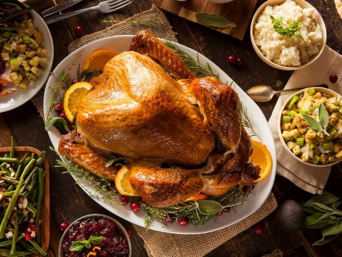turkey and thanksgiving feast laid out on table